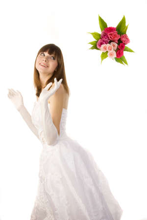 out of engagement: Young beautiful bride tossing a bouquet, side view, isolated on  white background.