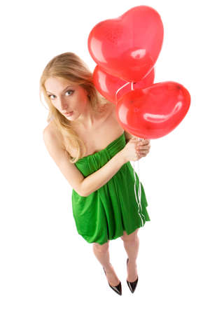 helium: Young beautiful woman standing with three red heart-shape helium balloons, isolated on white background Stock Photo