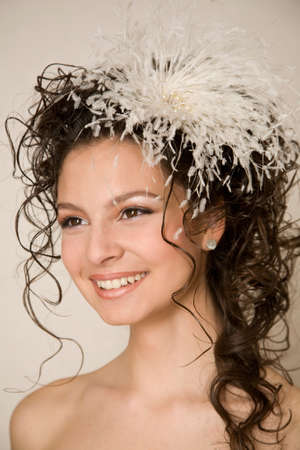 hairpin: Sweet smiling bride with feather hairpin in her hair