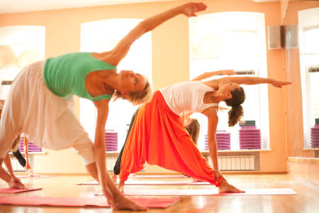 three people only: Three women is doing yoga at health club