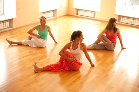 yoga class: Three women is doing yoga at health club