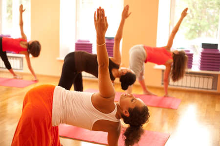 woman exercising: Young woman is doing yoga at health club Stock Photo