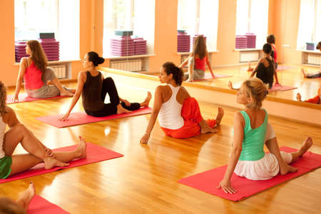 yoga pose: Women practicing yoga at health club Stock Photo