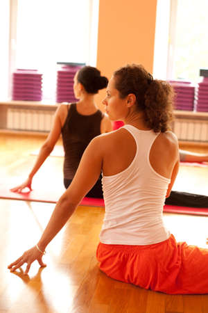 yoga class: Young woman is doing yoga at yoga club Stock Photo