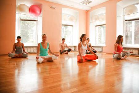 yoga man: Group practicing yoga