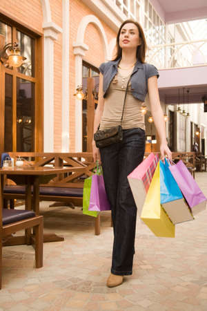 personal shopper: Young woman at shopping mall,walking through small restaurant