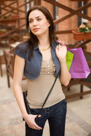 personal shopper: Young woman at shopping mall with shopping bags