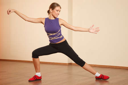 Young woman at gym is practicing Tai Chi Stock Photo