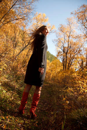 angle view: Happy girl in autumn forest.Low angle view Stock Photo