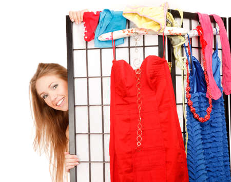 screen partition: Young beautiful woman looks out of the folding screen ,lots of clothes and underwear hang on it