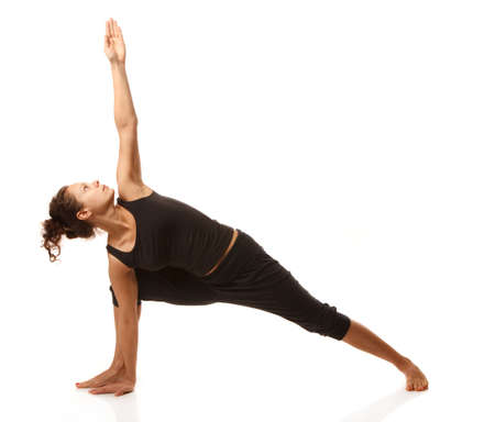 Woman yoga instructor doing yoga pose
