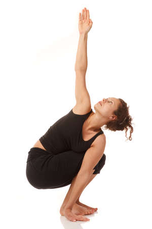 Young woman yoga instructor poses indoors,isoleted on white background