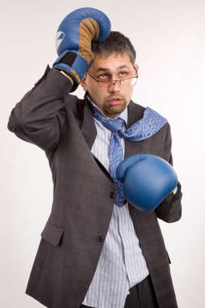 Exhausted businessman with boxing gloves