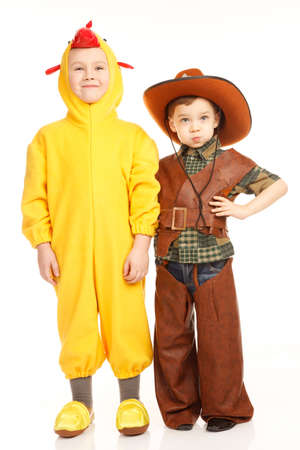 only two people: Two boys in costumes -in cowboy and in the chicken