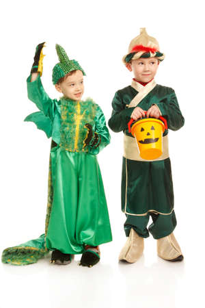 dragon vertical: Two little boys in costumes - in samurai and dragon with Halloween basket asking for candies
