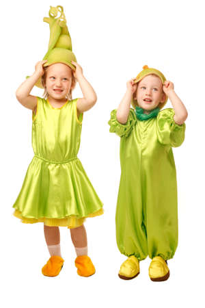 Sweet little brother and sister are playing with their costumes - pear and pea pod Stock Photo