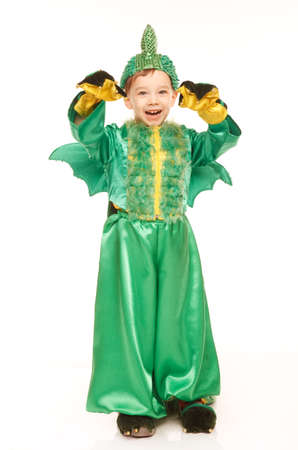 Little happy boy in dragon costume on the white background Stock Photo