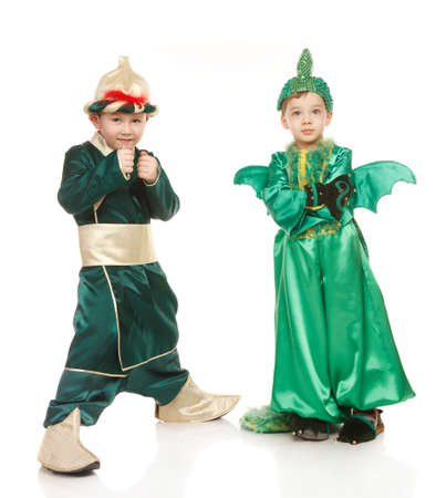 dragon vertical: Two little boys in costumes - in samurai and dragon