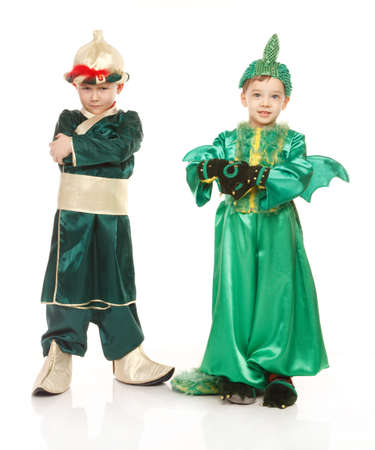 Two little boys in costumes - in samurai and dragon