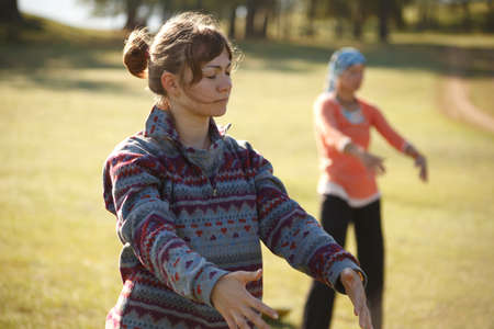 Two women are practicing Qi Gong Stock Photo