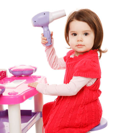 hairdryer: Little girl playing with toy hairdryer
