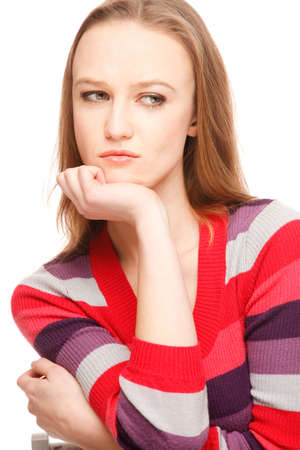 Young serious woman in colorful sweater poses Imagens