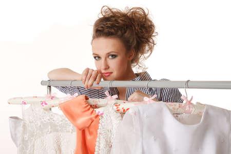 Young beautiful woman is choosing wedding dress Stock Photo