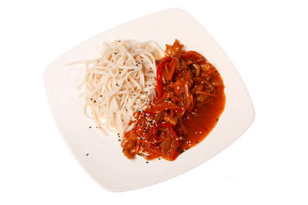 Asian food, noodles on the plate, isolated