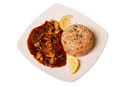 Asian food - roasted meat and vegetables and rice on plate, isolated