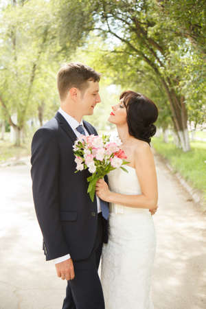 Beautiful just married couple outdoors Stock Photo