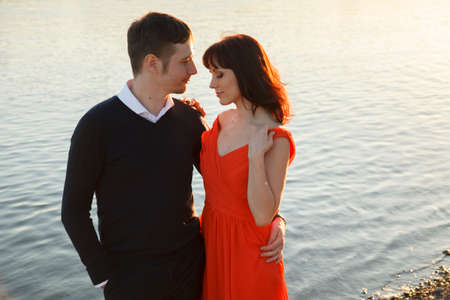 Young couple near water