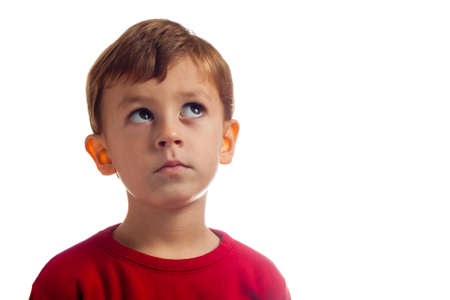 Child thinks while posing for camera Stock Photo