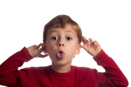 Little blond boy making funny faces  Stock Photo