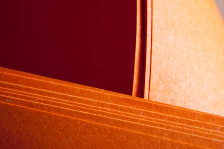 folds: Orange paper textured grunge paper folds Stock Photo