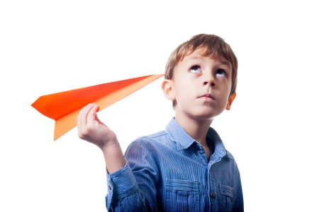 Boy with orange paper plane photo