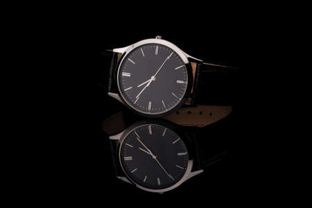 Mens wrist watch on black background. Studio shoot. photo