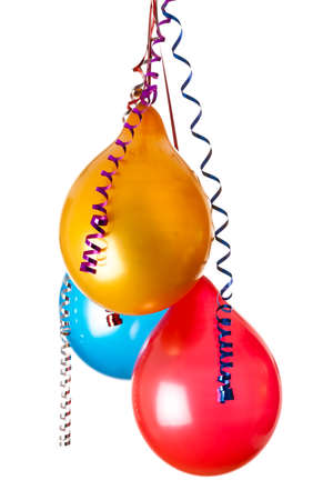 colored balloons isolated on white with hanging holiday streamers photo
