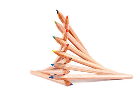 creatively: creatively stacked pencils of different colors on white