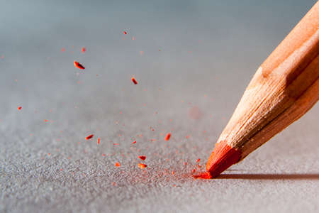 close up of color pencil head breaking photo