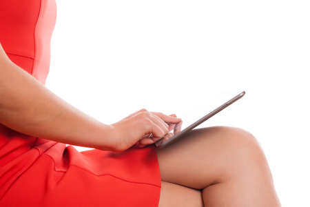 businesswoman legs: businesswoman legs with tablet and red office dress