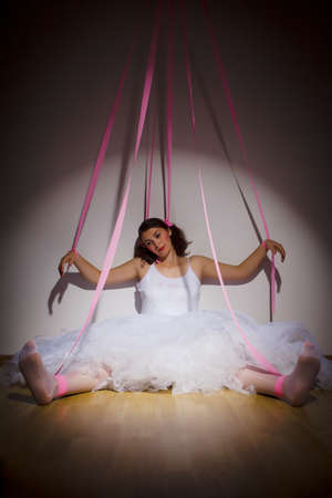 puppet woman: woman portraid as a marionette puppet controlled by strings