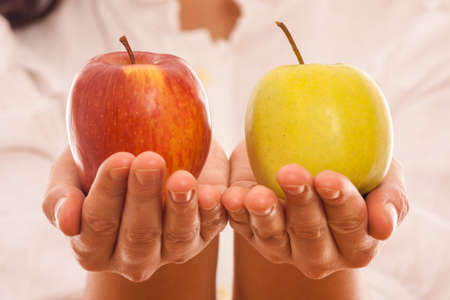 woman holding in hand two fresh natural healthy  apples photo