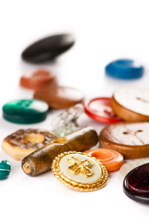various vintage color clothing buttons on white table photo