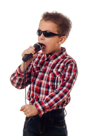 boy in sunglasses checkered shirt and jeans singing