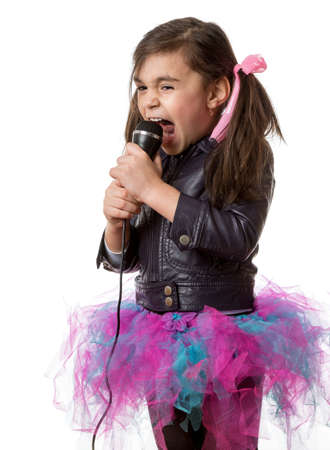 young little girl with microphone singing on white background
