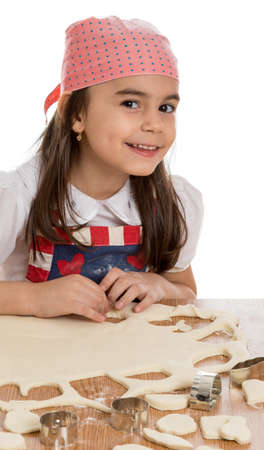 young little girl making different forms out of dough photo