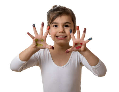 Funny little girl with hands and fingers painted in colorful paint photo