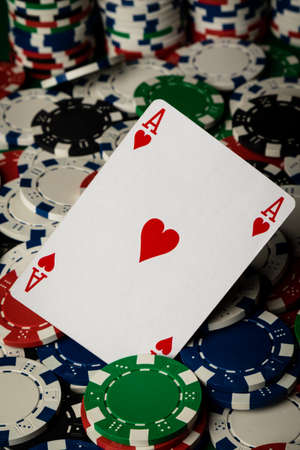 ace of hearts: Ace of hearts on many poker chips spread on table