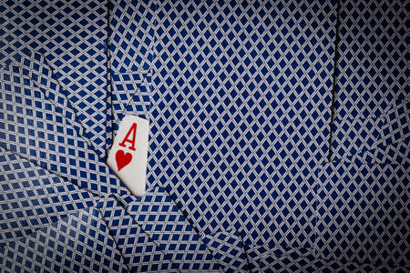 ace of hearts: poker cards spread on table with ace of hearts showing Stock Photo