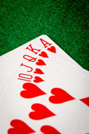 straight flush: Hearts straight flush poker cards on green table